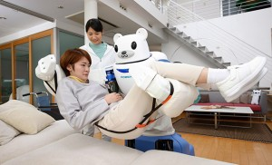 Robear lifting someone from the bed as the care worker looks on (source: http://bit.ly/1A1Ippz).