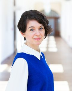 Portrait of Swetlana Torno, a woman in a blue top and with shorter brown hair